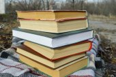 Pile of books on the plaid, park — Stock Photo