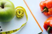 Vegetables and fruits for weight loss, a measuring tape, diet, weight loss — Foto de Stock