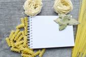 Recipe book, Notepad,cooking,spices on wooden background — ストック写真
