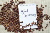 A hot Cup of coffee,coffee beans,Notepad,cinnamon,spices — Stock Photo