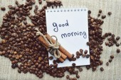 A hot Cup of coffee,coffee beans,Notepad,cinnamon,spices — ストック写真
