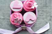 Pink cupcakes, with cream ,decorated with hearts — Stock Photo