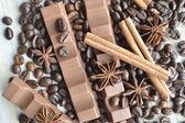 Chocolate, coffee, cinnamon, hazelnut, star anise — Stock Photo