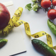 Vegetables and fruits for weight loss, a measuring tape, diet, weight loss, measuring tape, healthy eating, healthy lifestyle concept.Notepad,diary,eggplant,Apple,pear — Stock Photo #66125767