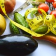 Vegetables and fruits for weight loss with a measuring tape — Stock Photo #66126689