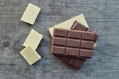Chocolate bars and pieces — Stock Photo