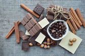 Chocolate bars, candies, cinnamon, nuts, anis and coffee beans — Stock Photo