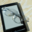 Black e-book for reading and reading glasses — Stock Photo #69955597