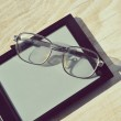 Black e-book for reading and reading glasses — Stock Photo #69955711