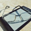 Black e-book for reading and reading glasses — Stock Photo #69955733