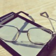 Black e-book for reading and reading glasses — Stock Photo #69955741