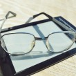 Black e-book for reading and reading glasses — Stock Photo #69955753