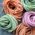 Colorful raw italian pasta — Stock Photo #69955773