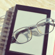 Black e-book for reading and reading glasses — Stock Photo #69956213