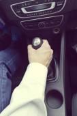 Man shifting manual gearbox in car — Stock Photo