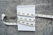 Empty notebook and measuring tape — Stock Photo