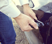 Male hand with car keys opening car door — Stock Photo