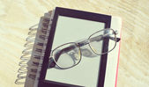 Black e-book for reading and reading glasses — Stock Photo