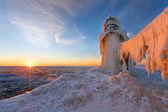 Sunset on a frozen St. Joseph Michigan pier - Michigan — Stock Photo