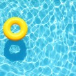 Постер, плакат: Yellow pool floats in a swimming pool