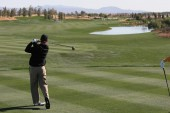 Man golf swing on a golf course — Stock Photo