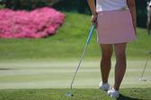 Lady golfer on putting green — Stock Photo