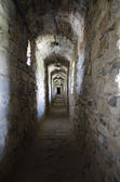 Tunnel in a medieval castle-fortress in Kamenetz-Podolsk. Ukraine — Stock Photo