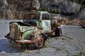 Rusty green vintage truck by a quarry. — Stock Photo