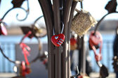 Red combination lock in the shape of a heart — Stock Photo
