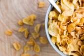 Grey bowl of golden cornflakes — Stockfoto