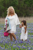 Grandma and Granddaughter stroling in Easter TX Bluebonnets — Stock Photo
