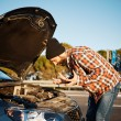Young male standing by car and looking at broken down car vehicl — Stock Photo #70182451