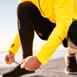 Постер, плакат: Running shoes Barefoot running shoes closeup Man tying laces b