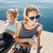 Runners resting taking a break drinking water after running outd — Stock Photo #75265783