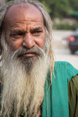 Homeless man with beard, unhygienic — Stock Photo