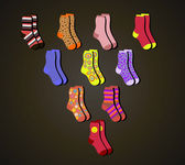 Vector colorful socks a triangle on a brown background — Stock Vector