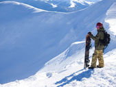 Snowboarder with Splitbord in the mountains. — Stock Photo