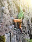 Rock climber climbs the wall. — Stock Photo