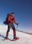 Mountaineer snowshoe is the snow. — Stock Photo