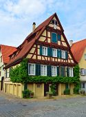 Old typical German house - Timber framing - with vines — Stock Photo