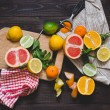 Citrus Fruits on the chopping board — Stock Photo #67111327
