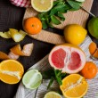 Citrus Fruits on the chopping board — Stock Photo #67329901