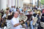 A musician with a french horn in an orchestra  in Havana, Cuba on May 10, 2013. — Stock Photo