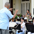 The conductor with brass band in Havana,  Cuba in Central Park square on May 10, 2013. — Stock Photo #68262481