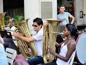 Musicians with a tubes  in an orchestra in Havana,  Cuba in Central Park square on May 10, 2013. — Stock Photo