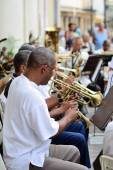 Musicians with a trumpets in an orchestra in Havana,  Cuba in Central Park square on May 10, 2013. — Stock Photo