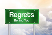 Regrets, Behind You Green Road Sign, business concep — Стоковое фото