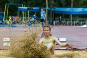 Girl competes in the long jump competition — Stock Photo