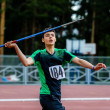 Постер, плакат: Young male athlete about to throw javelin