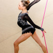 Girl gymnast performs with a rope at the competition — Stock Photo #76611139